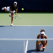 Ash Barty serves next to her partner Casey Dellacqua during their 6-4 6-1 first round win over Sorana Cirstea of Romania and Yanina Wickmayer of Belgium on Day 4 of the 2013 US Open in Flushing Meadows; Getty Images
