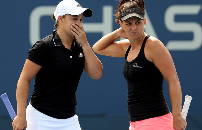 Ash Barty (L) and Casey Dellacqua of Australia talk tactics during their 6-3 6-4 second round win against Petra Cetkovska of Czech Republic and Kirsten Flipkens of Belgium at the 2013 US Open; Getty Images