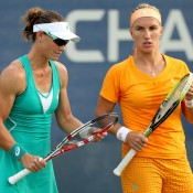 Sam Stosur (L) talks tactics with her partner Svetlana Kuznetsova of Russia during their 7-5 4-6 6-3 second round loss to fourth seeds Su-Wei Hsieh of Chinese Taipei and Shuai Peng of China on Day 6 of the 2013 US Open; Getty Images