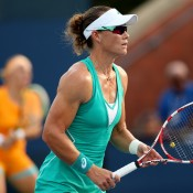 Sam Stosur (R) in action next to her partner Svetlana Kuznetsova of Russia at the 2013 US Open; Getty Images
