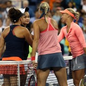 Casey Dellacqua (L) and Ash Barty (second from left) shake hands with Andrea Hlavackova (far right) and Lucie Hradecka after the Czechs defeated the Aussies 6-7(4) 6-1 6-4 in the US Open women's doubles final in New York City; Getty Images