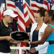 Former top 10 player Chanda Rubin (R) presents the US Open women's doubles runner-up trophy to Ash Barty (L) and Casey Dellacqua; Getty Images