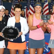 US Open women's doubles champions Andrea Hlavackova (far right) and Lucie Hradecka (second from right) and runners-up Ash Barty (far left) and Casey Dellacqua pose with their trophies following the final on Arthur Ashe Stadium at Flushing Meadows in New York; Getty Images
