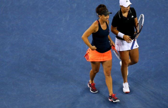 Ash Barty (R) and Casey Dellacqua of Australia in action during the women's doubles final against Czechs Andrea Hlavackova and Lucie Hradecka on Arthur Ashe Stadium on Day 13 of the 2013 US Open; Getty Images