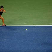 Casey Dellacqua plays a forehand behind her partner Ash Barty during the US Open women's doubles final at Flushing Meadows; Getty Images