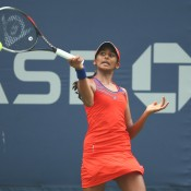 Naiktha Bains of Australia plays a forehand against Sandra Samir of Egypt during her junior girls' singles first round match on Day 8 of the 2013 US Open; Getty Images
