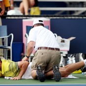 Bradley Mousley receives a medical time-out during his junior boys' singles 6-4 6-2 first round loss to Gerardo Lopez Villasenor of Mexico at the 2013 US Open; Getty Images