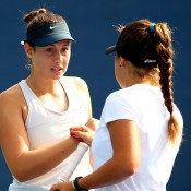 Sara Tomic (L) and Brazilian partner Carolina M. Alves in action during their 6-2 6-2 girls' doubles first round loss to top-seeded Czechs Barbora Krejcikova and Katerina Siniakova at the US Open in New York; Getty Images