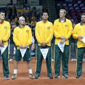 Australia's Davis Cup team of (L-R) Bernard Tomic, Lleyton Hewitt, Nick Kyrgios, Chris Guccione and captain Patrick Rafter during the national anthem prior to the World Group Play-off tie between Poland and Australia at the Torwar Hall in Warsaw, Poland; Getty Images
