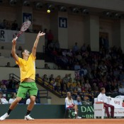 Bernard Tomic serves to Michal Przysiezny during the second singles rubber of the Australia v Poland Davis Cup World Group Play-off tie at the Torwar Hall in Warsaw, Poland; Getty Images