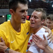 Bernard Tomic (L) celebrates with Lleyton Hewitt after Tomic's 7-5 7-6(1) 6-4 win over Michal Przysiezny in the second rubber of the Australia v Poland Davis Cup tie; Getty Images