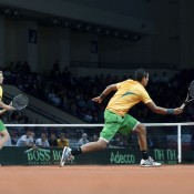 Nick Kyrgios (volleying) and Chris Guccione in action during the men's doubles rubber of the Australia v Poland Davis Cup tie in Warsaw. Despite an impressive Davis Cup debut for the 18-year-old Kyrgios, the Aussies went down 5-7 6-4 6-2 6-7(5) 6-4; Getty Images