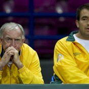 Tony Roche (L) and Marinko Matosevic watch from the sidelines as Bernard Tomic competes in the reverse singles rubber; Getty Images