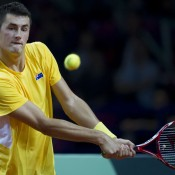 Bernard Tomic in action against Lukasz Kubot during the first reverse singles rubber of the Australia v Poland Davis Cup World Group Play-off tie in Warsaw, Poland; Getty Images