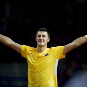 Bernard Tomic celebrates his 6-4 7-6(5) 6-3 victory over Lukasz Kubot in the reverse singles rubber in the Australia v Poland Davis Cup World Group Play-off tie. The win sealed an unassailable 3-1 lead for the Aussies in Warsaw; Getty Images