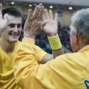 Bernard Tomic celebrates his tie-winning Davis Cup singles victory with Tony Roche; Getty Images