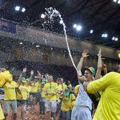 Australian Davis Cup captain Patrick Rafter (R) sprays champagne in celebration of Australia's 4-1 victory over Poland in the Davis Cup World Group Play-offs in Warsaw, promoting Australia to the World Group for the first time since 2007; Getty Images