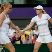 Anastasia Rodionova (R) of Australia in doubles action with Alla Kudryavtseva of Russia; Getty Images