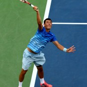 Bernard Tomic serves to Spaniard Albert Ramos during their men's singles first round match on Grandstand court on Day 1 of the 2013 US Open at Flushing Meadows in New York; Getty Images