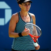 Despite winning the first set, Casey Dellacqua wasn't able to hold off the inspired Ajla Tomljanovic of Croatia, falling 3-6 6-1 6-4 in the first round of the US Open at Flushing Meadows; Getty Images