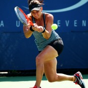 Having qualified for the main draw, Casey Dellacqua plays a backhand during her women's singles first round match against Ajla Tomljanovic of Croatia at the US Open; Getty Images