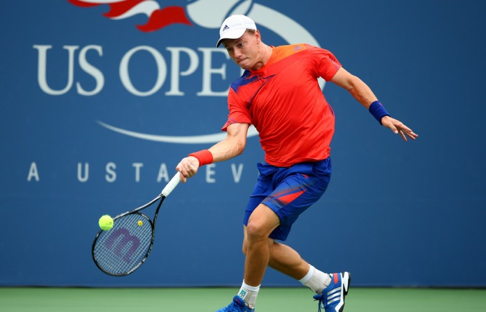 Playing a forehand, James Duckworth won the opening set of his first round match against fellow wildcard Tim Smyczek of the United States on Day 3 of the 2013 US Open, before ultimately going down in four sets; Getty Images