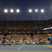 Beneath the lights of Arthur Ashe Stadium, Lleyton Hewitt serves during his men's singles second round match against Juan Martin Del Potro of Argentina on Day 5 of the 2013 US Open; Getty Images
