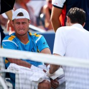 In the fifth set, Lleyton Hewitt received assistance from the trainer to tend to cuts on his elbow during his fourth round match against Mikhail Youzhny of Russia at the 2013 US Open; Getty Images