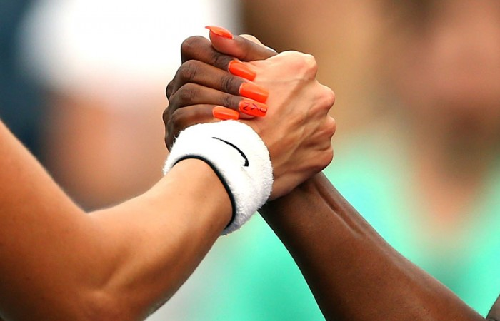 Sloane Stephens (R) shakes hands with Mandy Minella after winning their 2013 US Open first round match; Getty Images