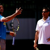 Jo-Wilfried Tsonga (L) works with Roger Rasheed during a practice session at Roland Garros in 2013; Getty Images