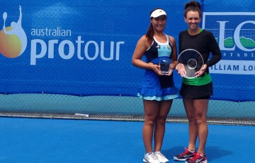 Casey Dellacqua (R) poses with the winning trophy alongside finalist Noppawan Lertcheewakarn of Thailand at the WM Loud Bendigo International Pro Tour event; Tennis Australia