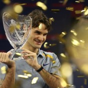 Shown here winning the season-ending ATP Tennis Masters Cup in Shanghai 2006, Federer's glittering season that year included three major titles (Australian Open, Wimbledon and US Open), a total of 12 tournament victories, and a stunning win-loss record of 92-5; Mark Ralston/AFP/Getty Images