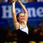 Martina Hingis celebrates winning the 1999 Australian Open title at Melbourne Park, a year in which she would end the season at world No.1. Hingis also clinched the year-end accolade in 1997 and 2000; Allsport
