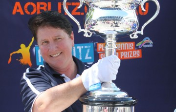 Kendall Tennis Club president Wendy Hudson holds the Australian Open women's singles trophy at a recent AO Blitz event in Port Macquarie, NSW; Tennis Australia