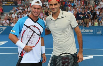 Lleyton Hewitt and Roger Federer (right), Brisbane International, 2014. GETTY IMAGES
