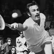 John Newcombe in action at Wimbledon; Getty Images