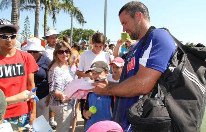 Pat Rafter signs autographs for fans after his win for Sunshine Coast Breakers in the ATL Queensland Conference against Gavin Van Peperzeel of the Tennis Brisbane Chargers; Tennis Queensland