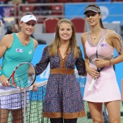 Sam Stosur (L) and Tsvetana Pironkova (R) pose for a photo prior to their round-robin match at the WTA Tournament of Champions in Sofia, Bulgaria; Desislava Kulelieva