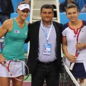 Sam Stosur (L) and Simona Halep (R) pose for a photo prior to the final of the WTA Tournament of Champions in Sofia, Bulgaria; Desislava Kulelieva