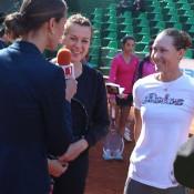 Sam Stosur (R) and Anastasia Pavlyuchenkova are interviewed prior to conducting a tennis clinic in Sofia, Bulgaria; WTA