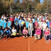 Sam Stosur and Anastasia Pavlyuchenkova pose with the kids they conducted a tennis clinic with in Sofia, Bulgaria; WTA
