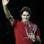 Roger Federer salutes the crowd after winning the 2007 Tennis Masters Cup in Shanghai, the fourth straight season he finished the year ranked No.1. He reclaimed the year-end mantle in 2009; Getty Images