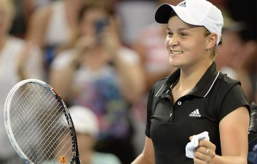 Ashleigh Barty of Australia celebrates victory after defeating Daniela Hantuchova of Sovlakia during day two of the 2014 Brisbane International at Queensland Tennis Centre; Getty Images