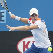 Ben Mitchell in action during the Australian Open Play-off at Melbourne Park; Emily Mogic