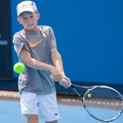 Dane Sweeny in action during the Australian 12-and-under Championships; Matt Johnson