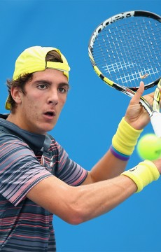 Thanasi Kokkinakis of Australia plays a backhand volley during his final round qualifying victory over Wu Di of Chinaat the 2014 Brisbane International; Getty Images