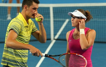 Bernard Tomic and Sam Stosur of Australia talk during the mixed doubles rubber against Canadians Milos Raonic and Eugenie Bouchard on Day 1 of the 2014 Hopman Cup at Perth Arena; Getty Images