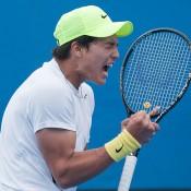 Akira Santillan celebrates his victory over Matt Reid in the first round of the Australian Open Play-off; Elizabeth Xue Bai