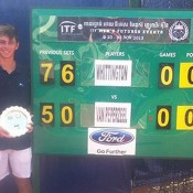 Andrew Whittington poses with the champion's trophy beside the scoreboard after his victory in the Phnom Penh ITF Futures final over fellow Australian and doubles partner Gavin Van Peperzeel; Andrew Whittington via Twitter