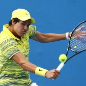 MELBOURNE, AUSTRALIA - JANUARY 18: Akira Santillan of Australia plays a backhand in his first round junior boys' match against Ken Onish of Japan during the 2014 Australian Open Junior Championships at Melbourne Park on January 18, 2014 in Melbourne, Australia.  (Photo by Matt King/Getty Images)